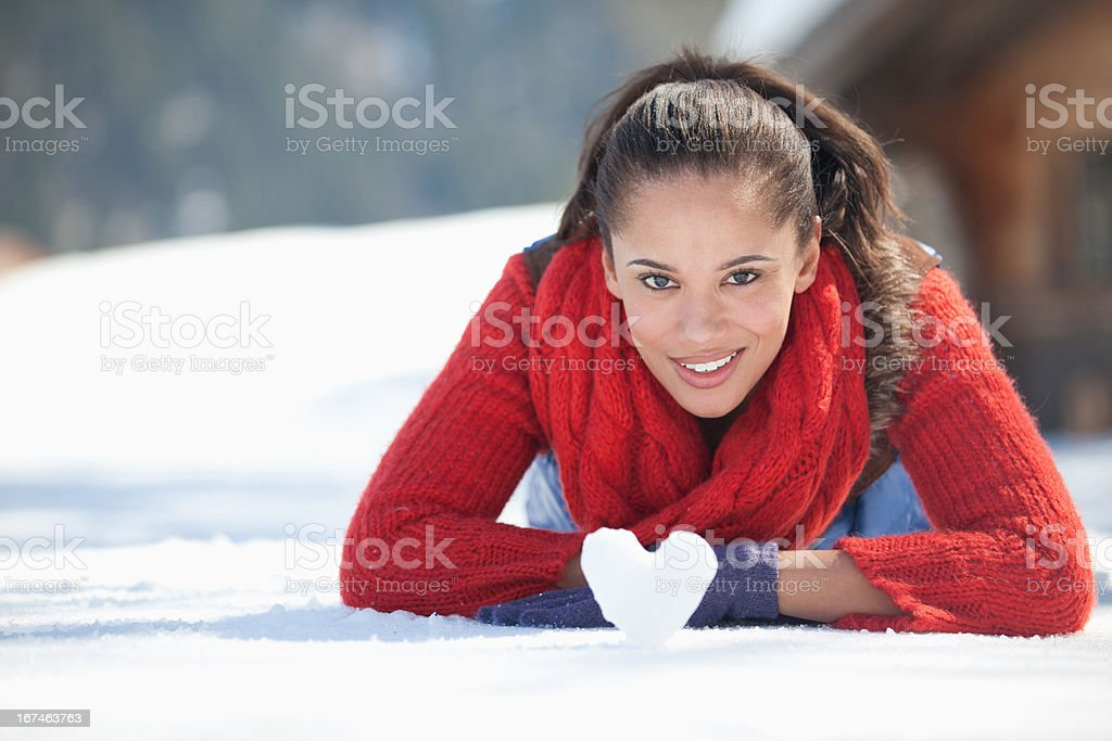 Young woman with heart-shaped snowball royalty-free stock photo