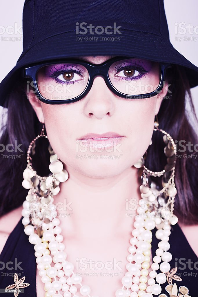 Young woman with heavy glasses and summer cap. royalty-free stock photo