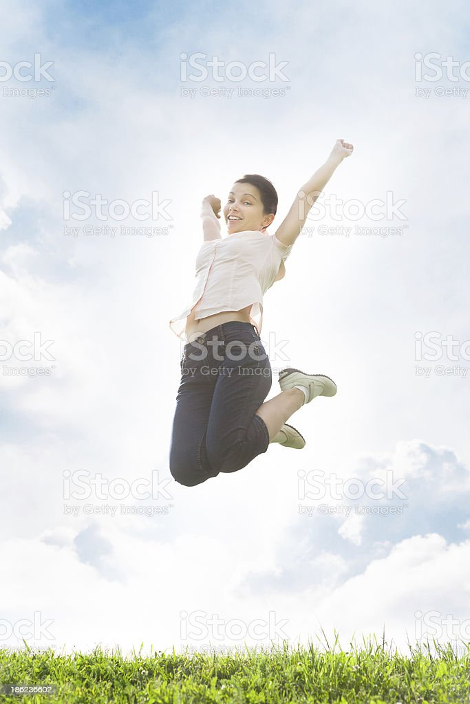 Young Woman With Her Arms Outstretched royalty-free stock photo