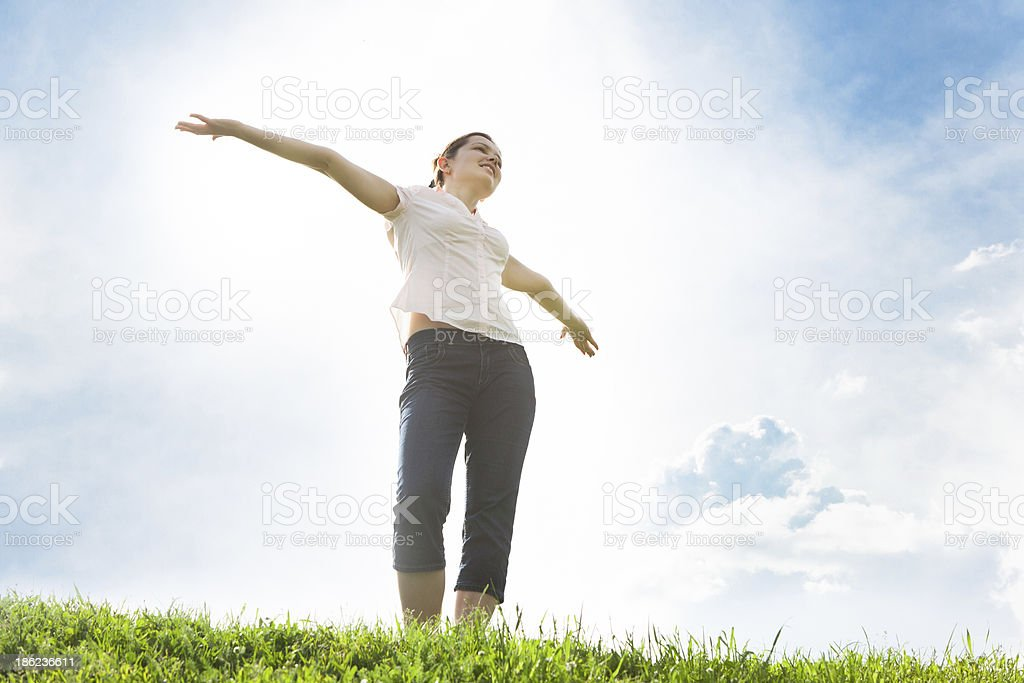Young Woman With Her Arms Outstretched stock photo