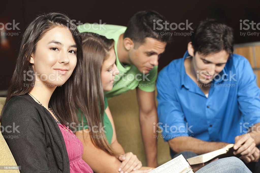 Young Woman With Her Bible Study Group royalty-free stock photo