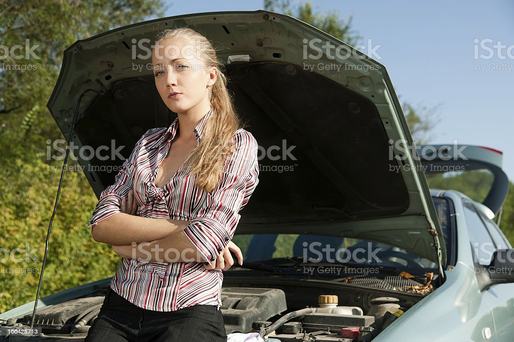Young woman with her broken car royalty-free stock photo
