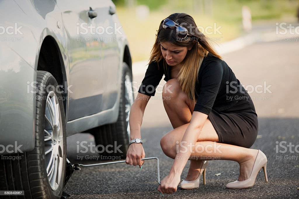 young woman with her broken car stock photo