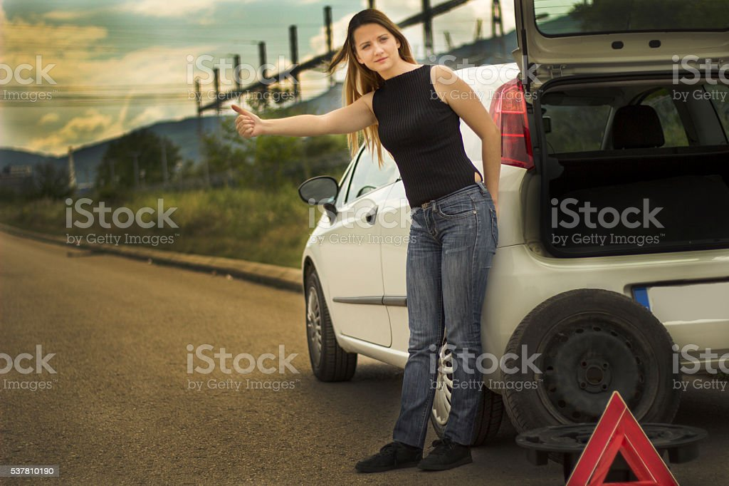 Young woman with her broken car. stock photo