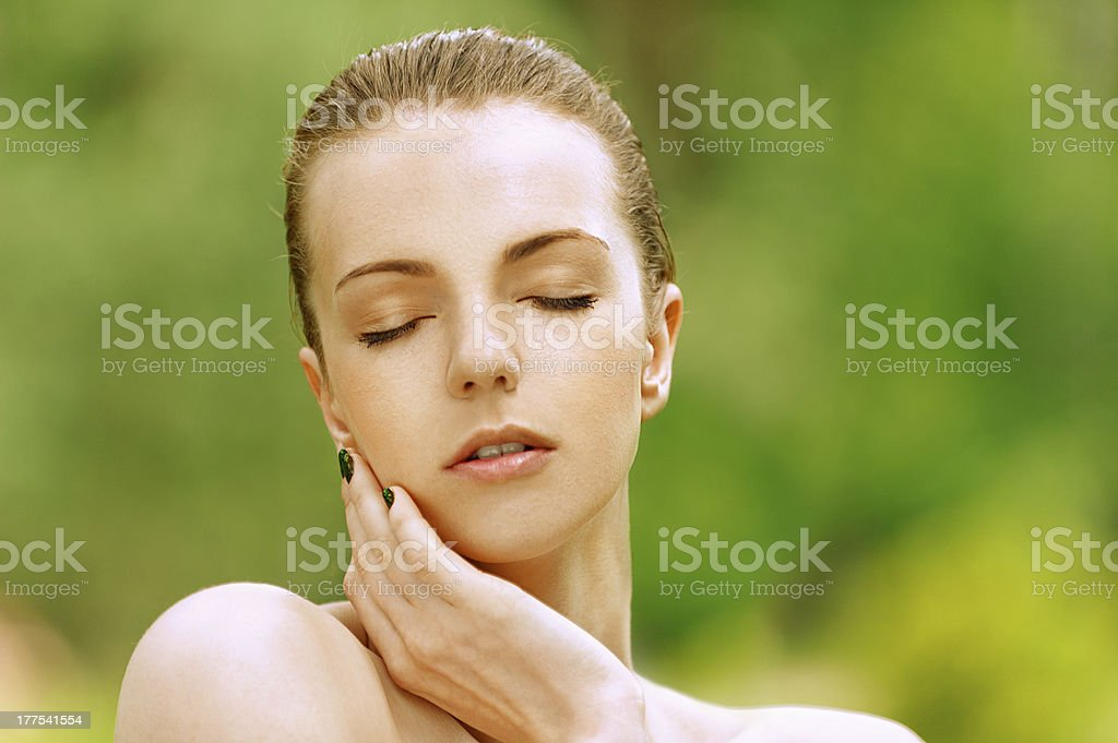 young woman with her eyes closed stock photo