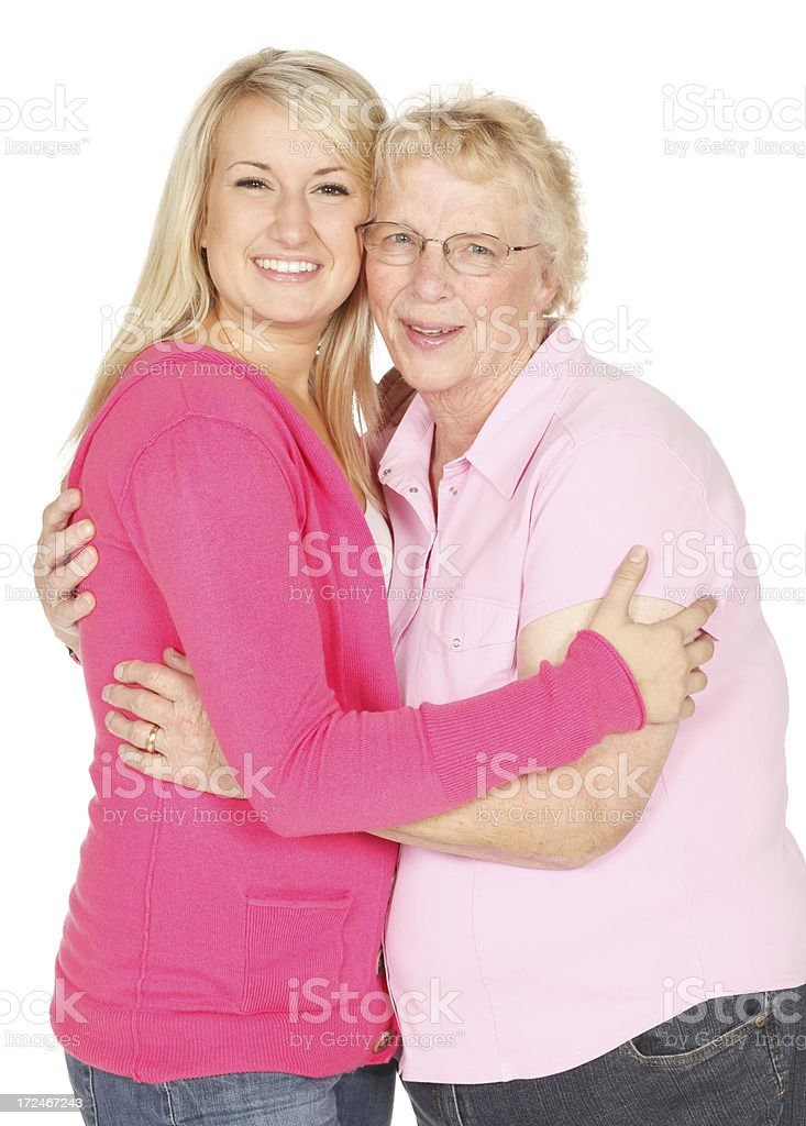 Young woman with her grandmother on white background. royalty-free stock photo