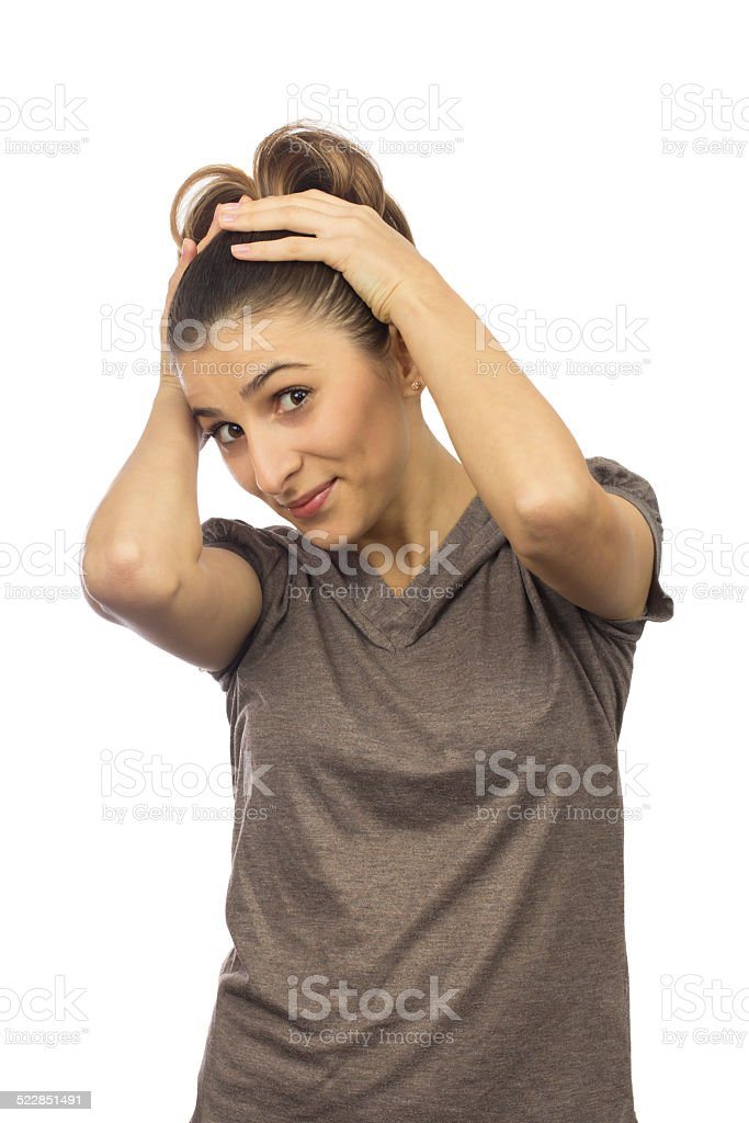 young woman with her hands on head stock photo