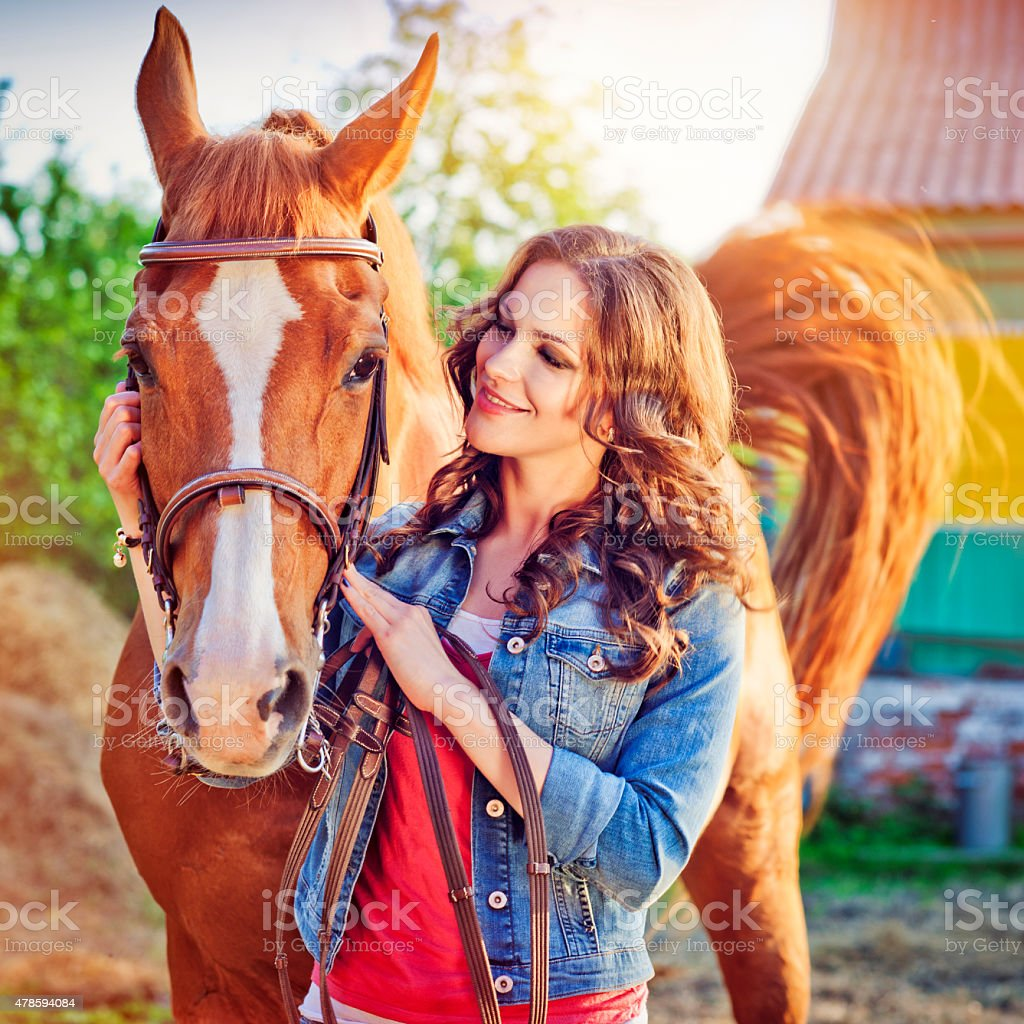 Young woman with her horse stock photo
