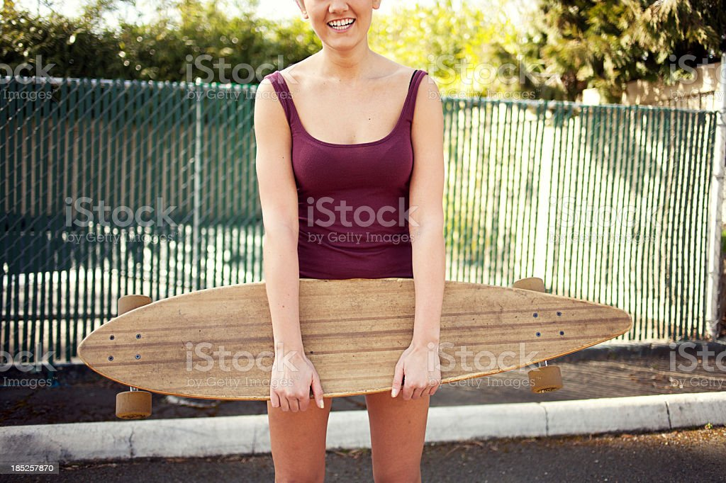Young woman with her longboard stock photo