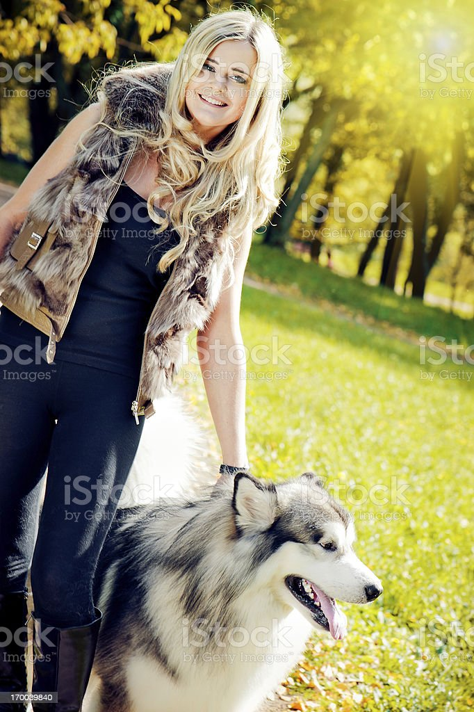 Young woman with her malamute dog royalty-free stock photo
