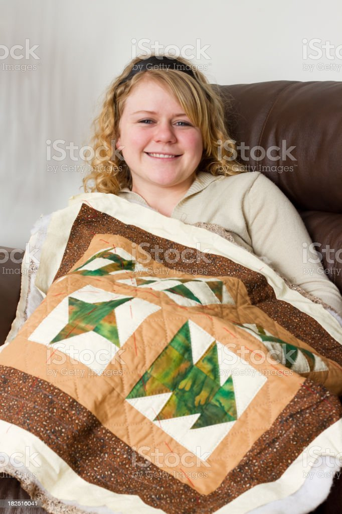 Young Woman With Her Quilt stock photo