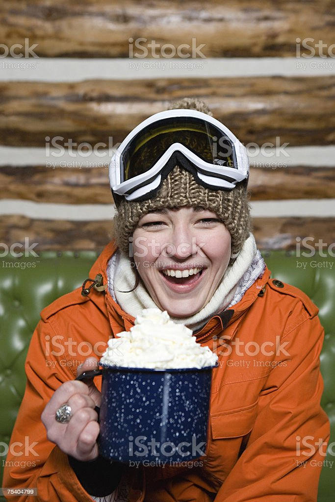Young woman with hot chocolate stock photo