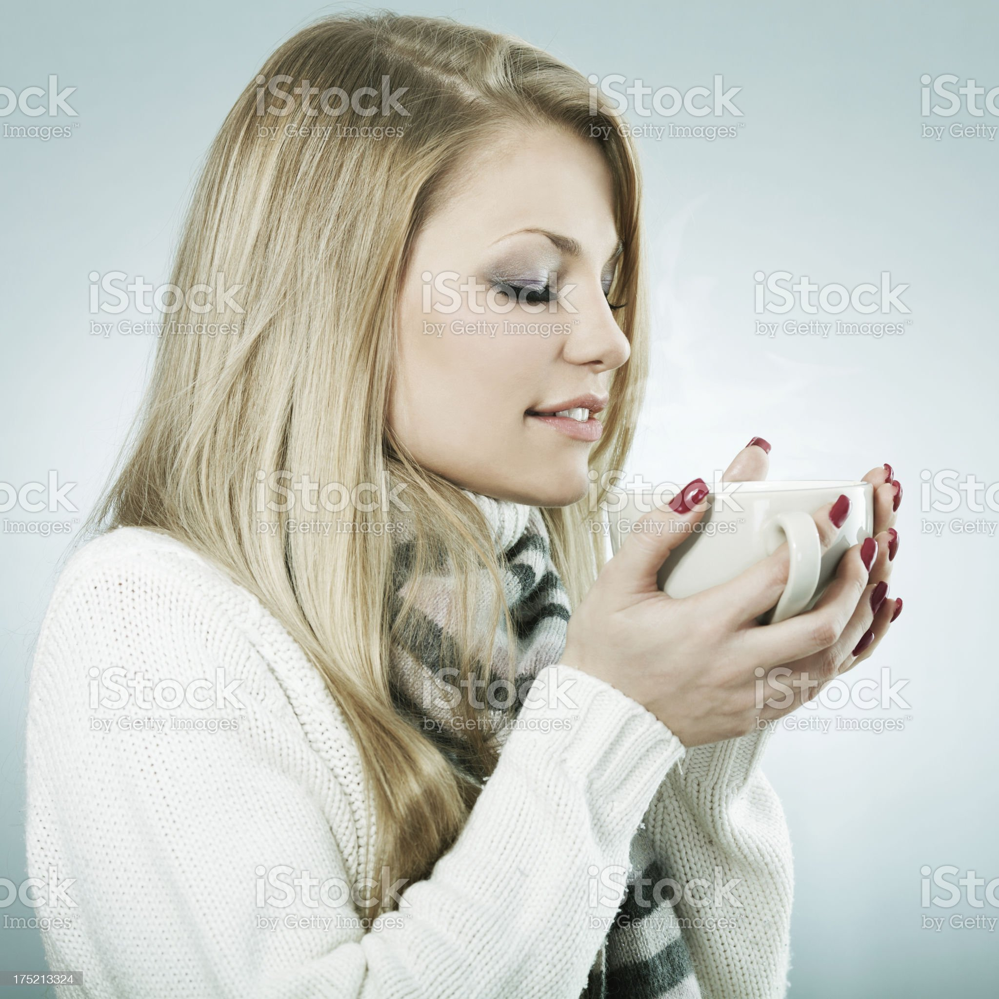 Young woman with hot drink royalty-free stock photo
