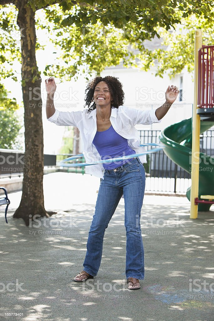 Young woman with hula hoop stock photo