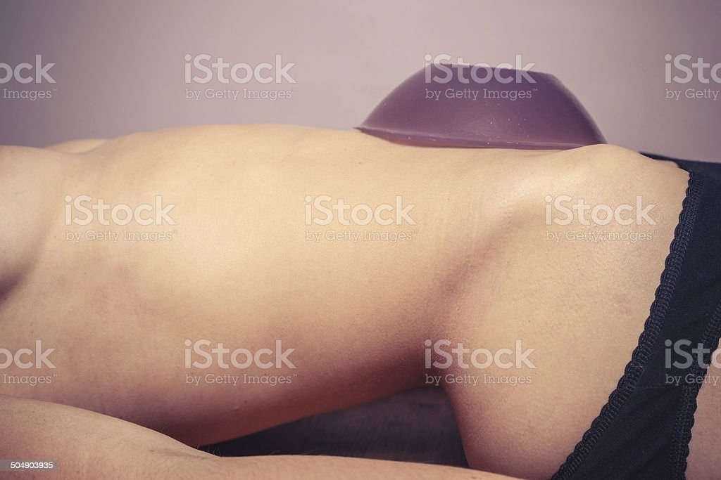 Young woman with jelly on her belly stock photo