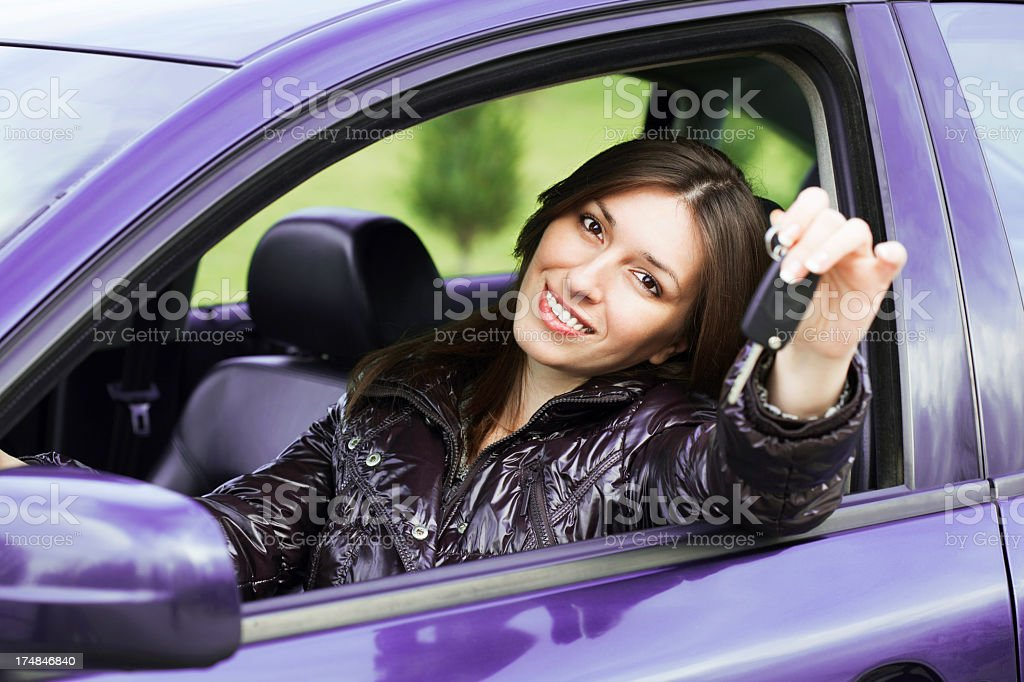 young woman with keys in car royalty-free stock photo