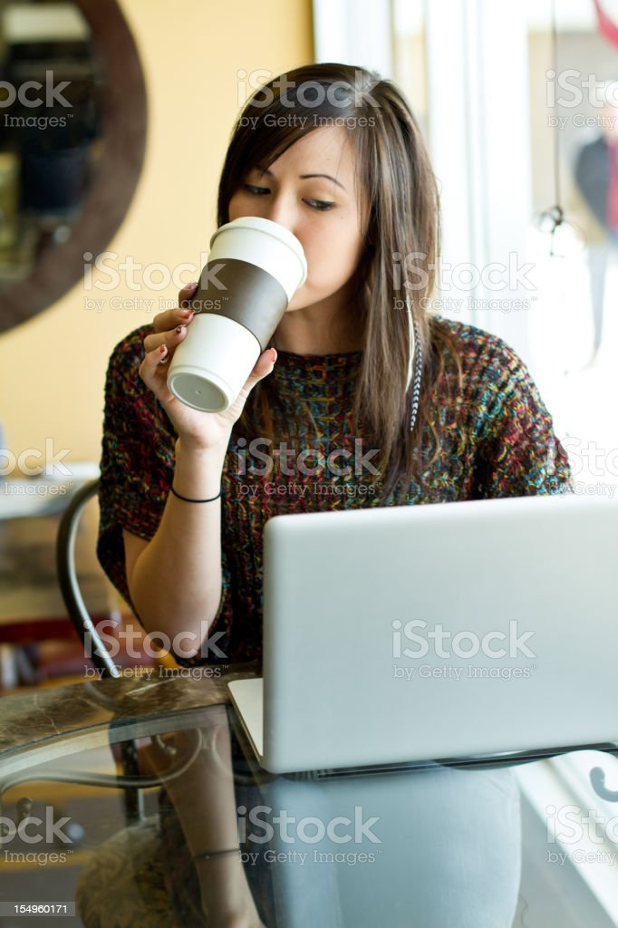 Young Woman with Laptop and To Go Coffee royalty-free stock photo