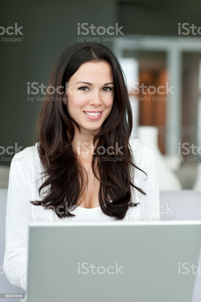 Young Woman with Laptop Computer at Home royalty-free stock photo