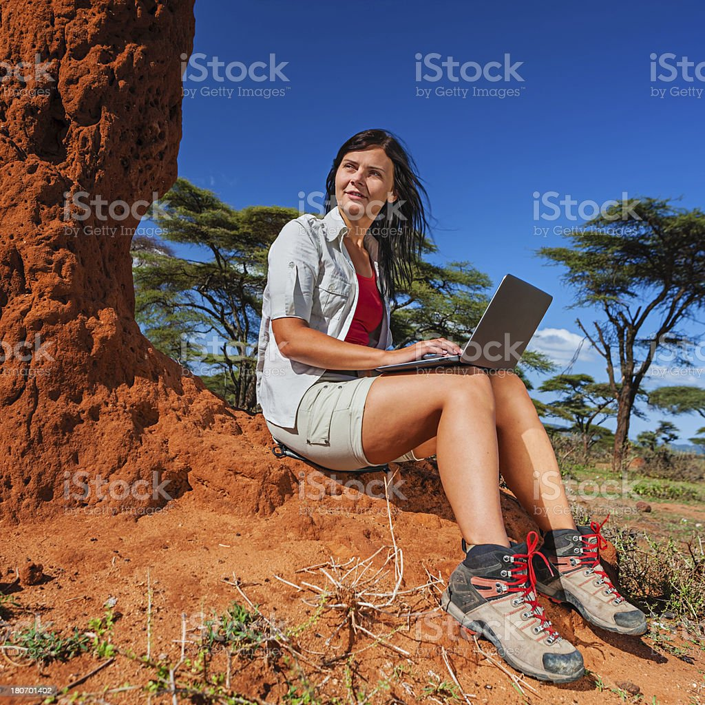 Young woman with laptop during safari in Africa royalty-free stock photo