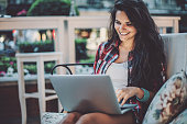 Young woman with laptop in the evening