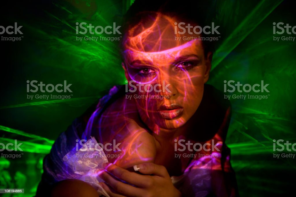 Young Woman with Laser Lights All Over royalty-free stock photo