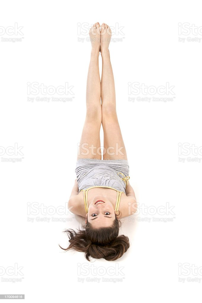Young woman with legs in the air stock photo