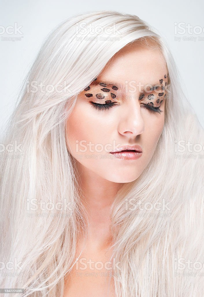 Young woman with leopard make-up royalty-free stock photo