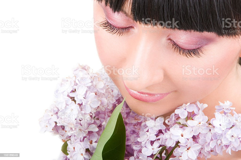 Young woman with lilac flowers royalty-free stock photo