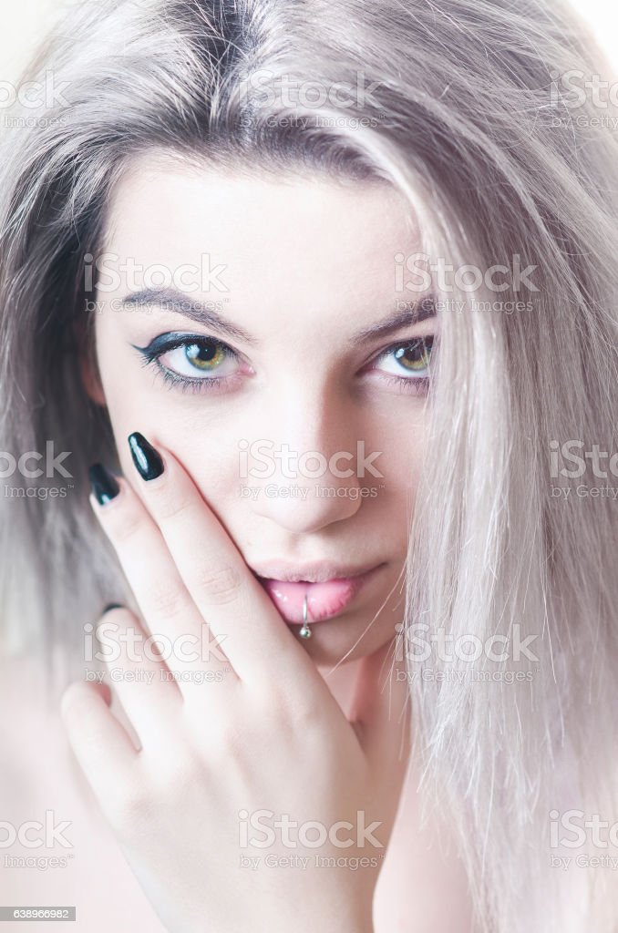 Young woman with lip piercing and grey hair portrait stock photo