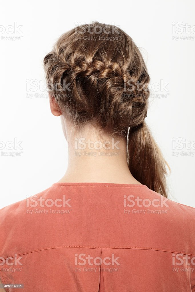 Young woman with long braided hair, close up stock photo