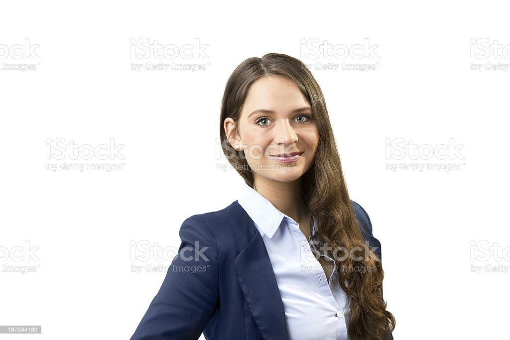 A young woman with long brown hair wears business clothes. stock photo