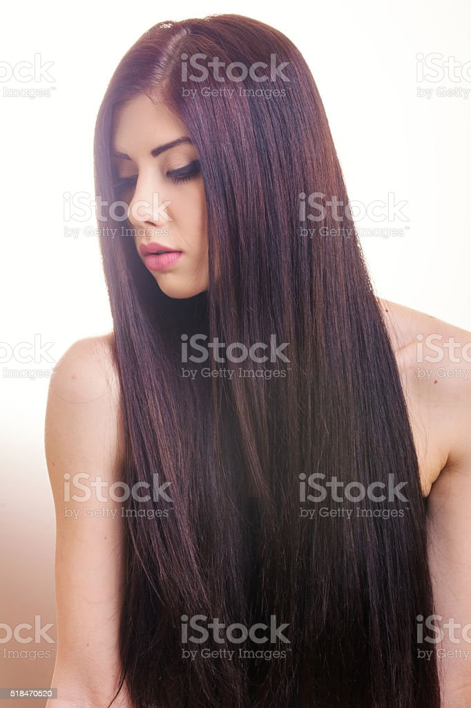 Young woman with long hair stock photo