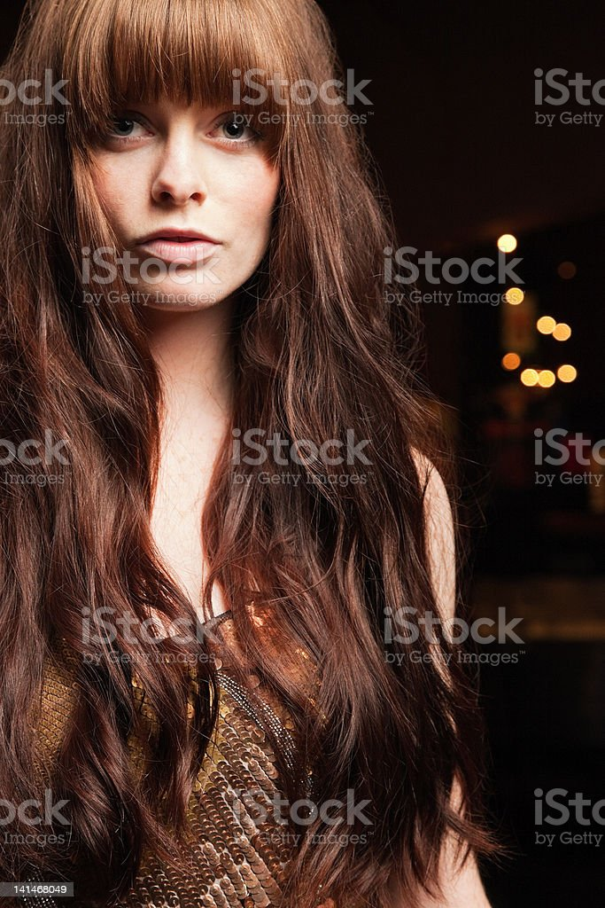 Young woman with long red hair stock photo