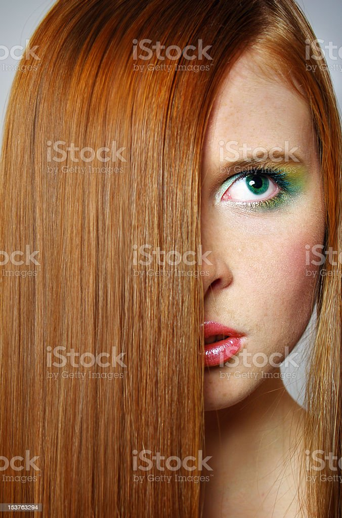 young woman with  long red hair royalty-free stock photo