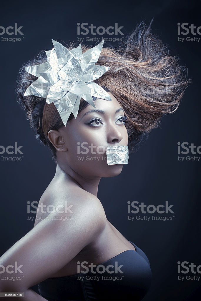 Young woman with long wavy hair royalty-free stock photo