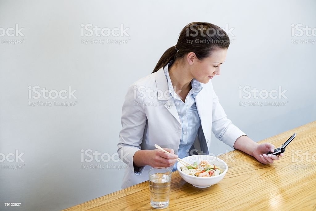 Young woman with lunch and cellphone royalty-free stock photo