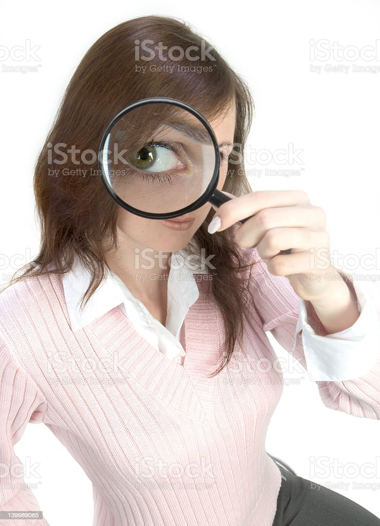 Young Woman with Magnifying Glass royalty-free stock photo
