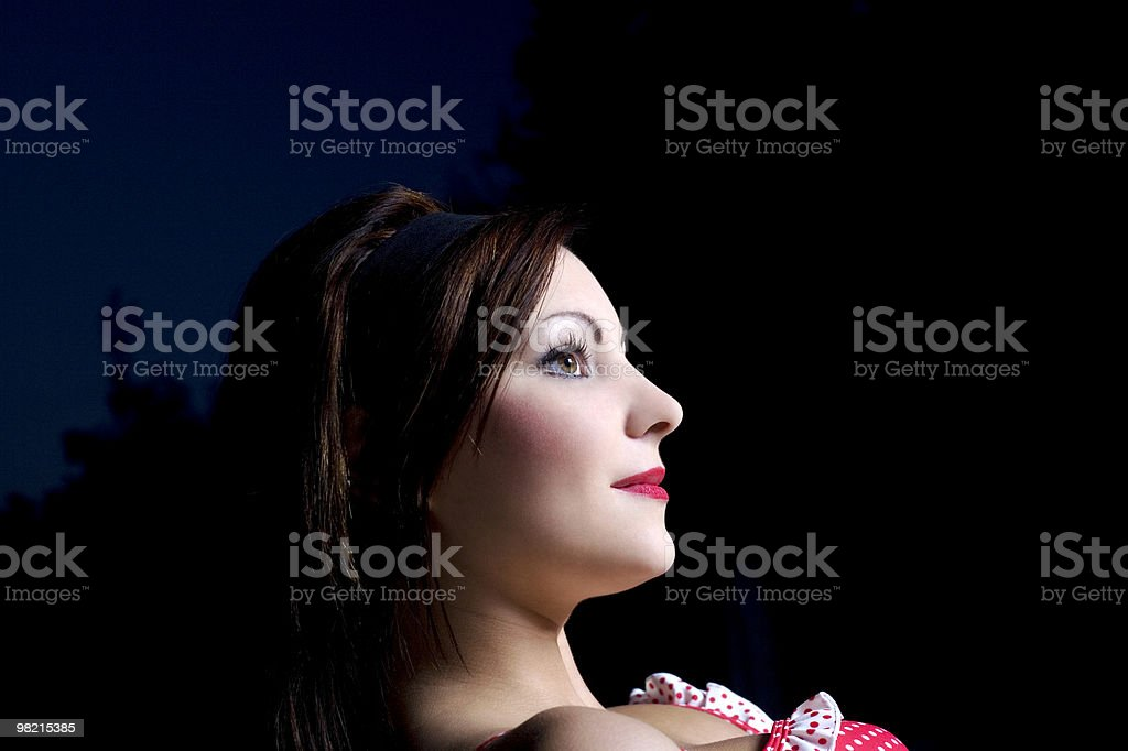 Young woman with make-up looking ahead, smiling stock photo
