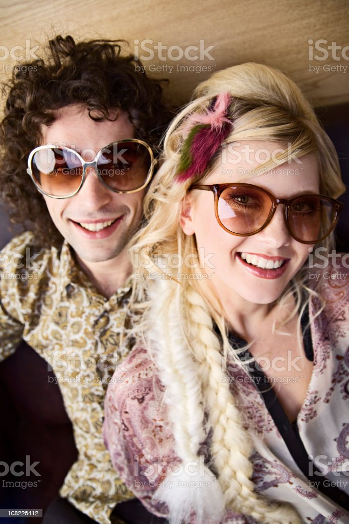 Young Woman with Man Smiling and Wearing Large Retro Sunglasses royalty-free stock photo