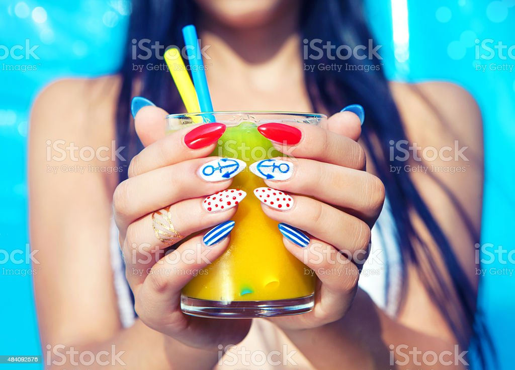 Young woman with marine sailor manicure stock photo