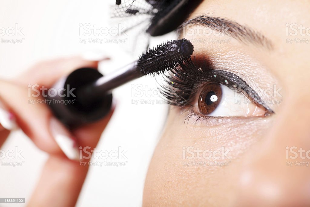 Young woman with mascara for her eyelashes. stock photo