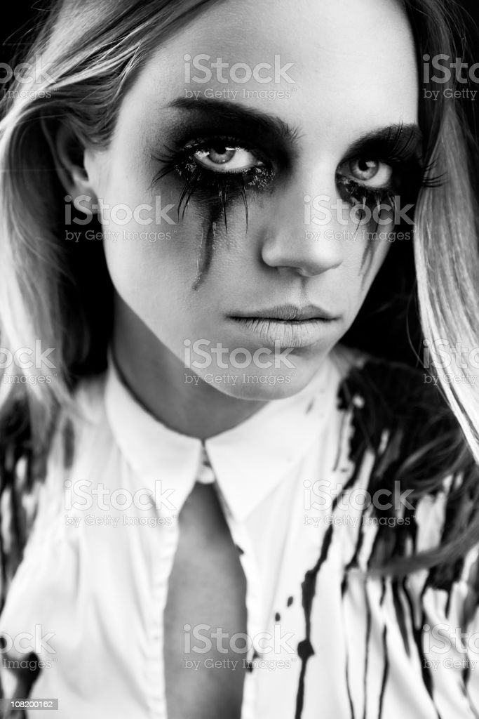 Young Woman with Mascara Running, Black and White stock photo