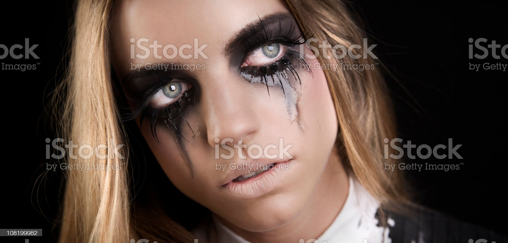 Young Woman with Mascara Running Down Cheeks Crying royalty-free stock photo