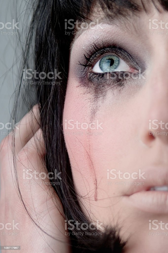 Young Woman with Mascara Running Down Face royalty-free stock photo