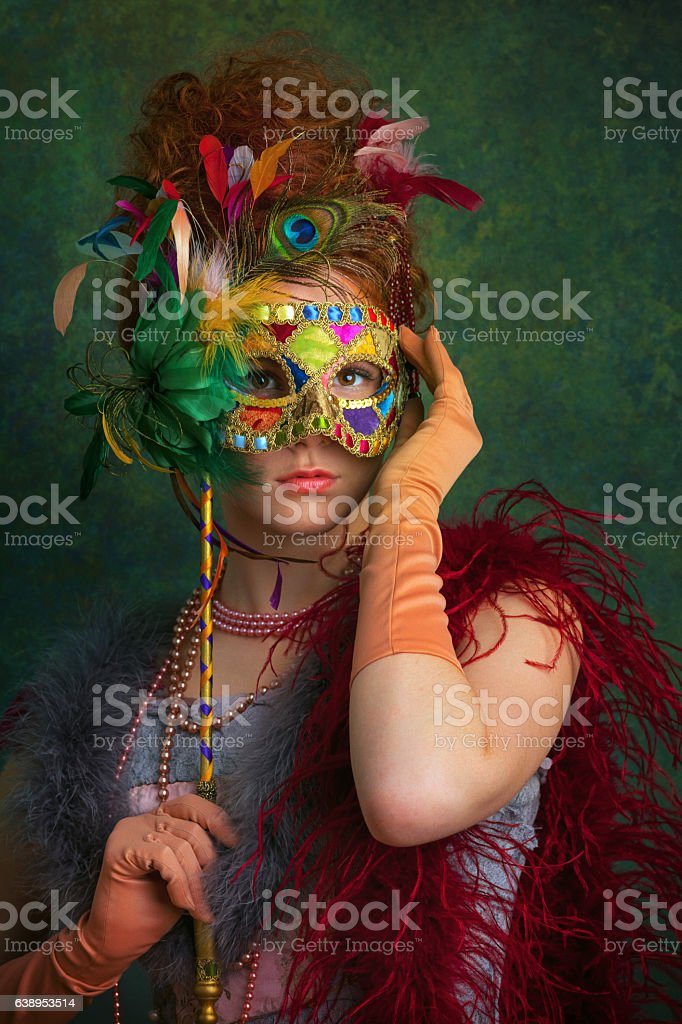 young woman with masquerade mask stock photo