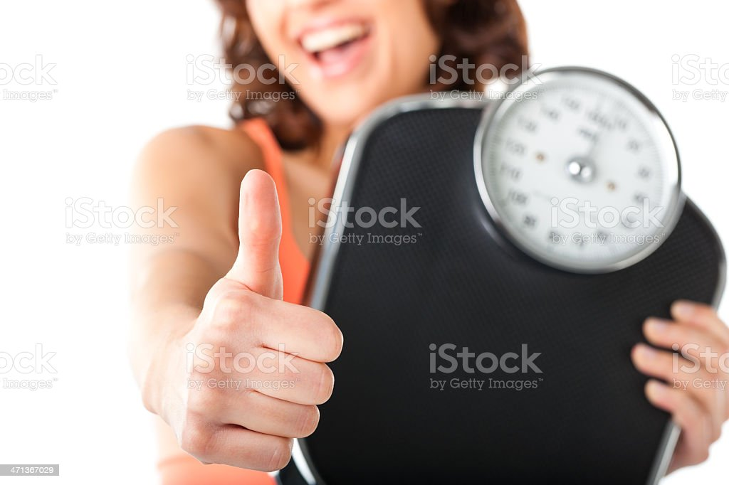 Young woman with measuring scale stock photo