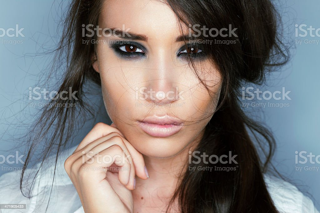 Young woman with messy hair and heavy eyeliner stock photo