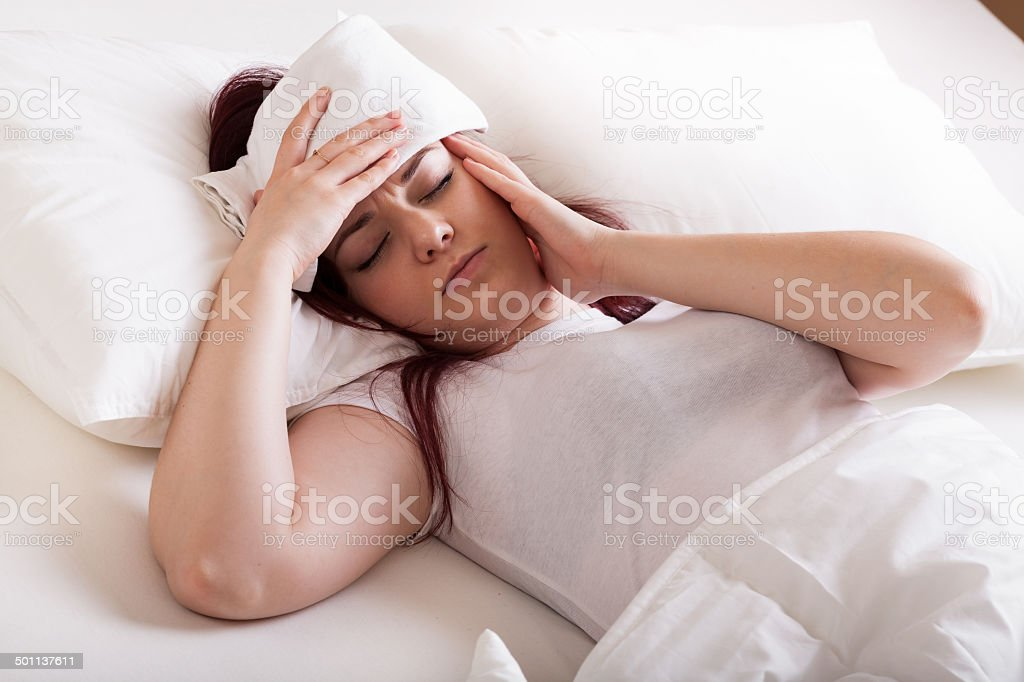 Young woman with migraine stock photo