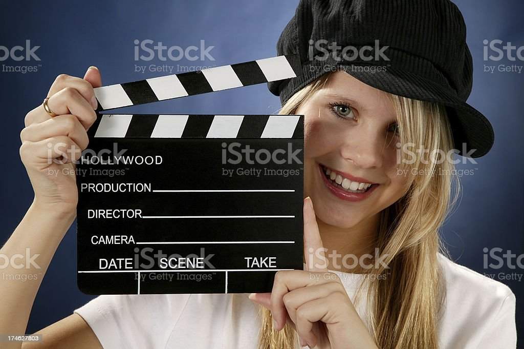 young woman with movie action clapboard stock photo