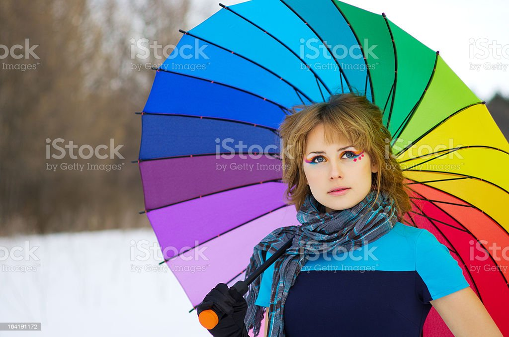 Young woman with multicolor umbrella royalty-free stock photo